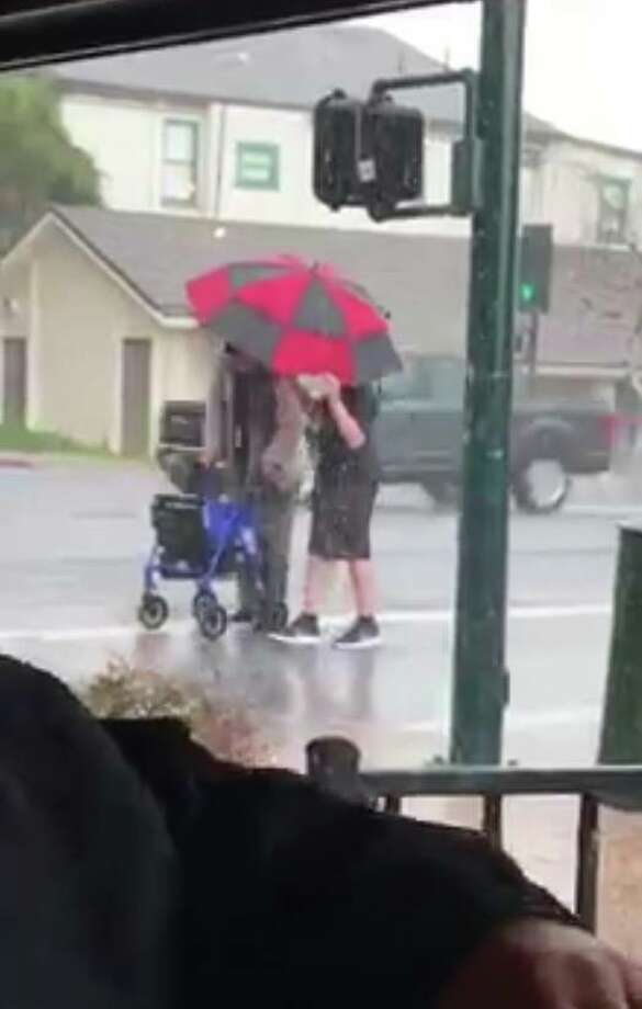 A Vallejo teen assisting an elderly person across the street during a hail storm. Photo: Rick Rock/Facebook