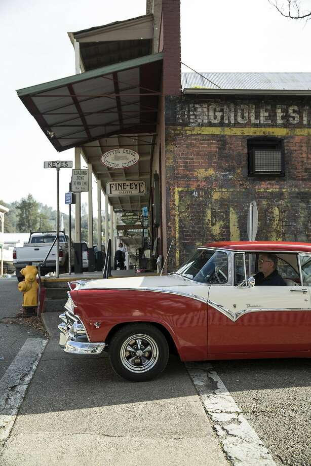 A man driving a vintage car pulls onto Main Street in Sutter Creek. The town has a historic Main Street with shops and restaurants. Photo: Laura Morton, Special To The Chronicle