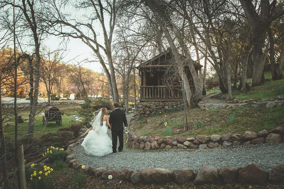 A bride and groom stroll through the grounds at Ironstone Vineyards. The winery offers options throughout the property for a one-of-a-kind wedding. Photo: Courtesy Ironstone Vineyards