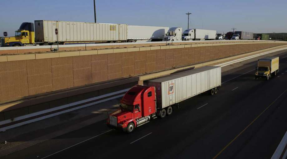 Trucks move along Interstate 35 in Laredo. Respondents to the National Association for Business Economic survey gave a highly favorable rating to NAFTA. Nearly 70 percent of respondents said the administration should only use policies such as tariffs to restrict trade when U.S. industries are being threatened by unfair trading practices. Photo: Eric Gay /Associated Press / Copyright 2016 The Associated Press. All rights reserved.