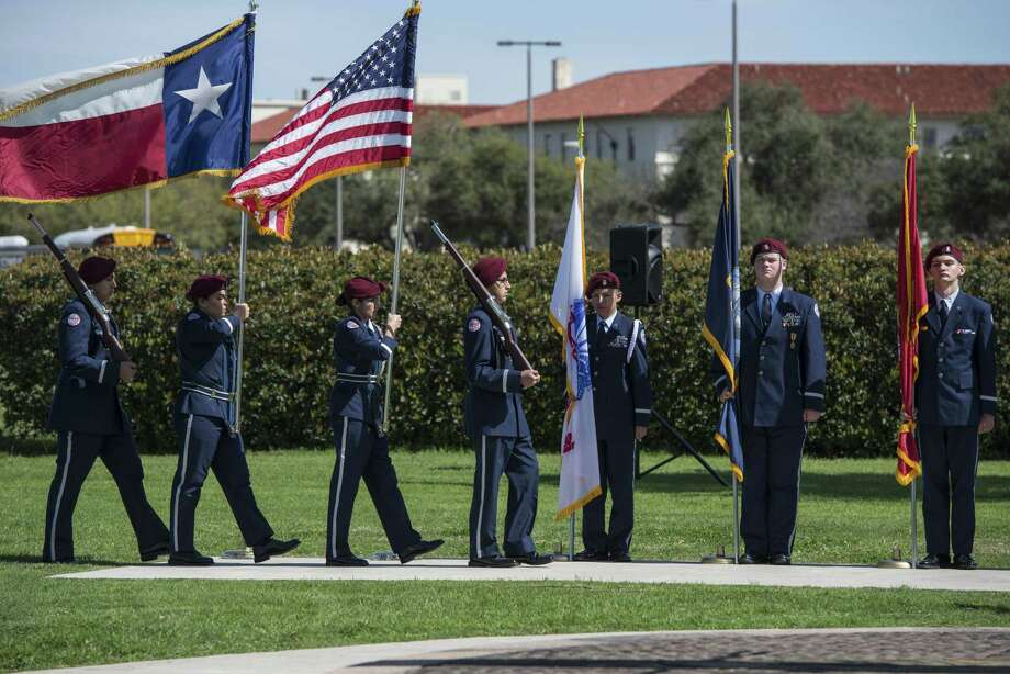 Members of Floresvillie High School Air Force JROTC present the colors at an event honoring Benjamin Foulois March 2, 2017 at Joint Base San Antonio-Fort Sam Houston. Foulois is credited with completing the first military flight in December 1910. (U.S. Air Force photo by Senior Airman Stormy Archer) Photo: Senior Airman Stormy Archer, 502nd Air Base Wing / 502nd Air Base Wing / Public Domain