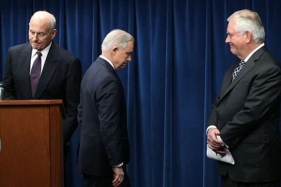 CORRECTED VERSION - WASHINGTON, DC - MARCH 06:  Attorney General Jeff Sessions (R), Secretary of Homeland Security John Kelly (L) and Secretary of State Rex Tillerson (C) take part in a news conference about issues related to a reconstituted travel ban at the U.S. Customs and Borders Protection headquarters, on March 6, 2017 in Washington, DC. Earlier today, President Donald Trump signed an executive order that excludes Iraq from the blacklisted countries but continues to block entry to the U.S. for citizens of Somalia, Sudan, Syria, Iran, Libya and Yemen. Kelly, Tillerson and Sessions left the news conference without taking questions.  (Photo by Mark Wilson/Getty Images)