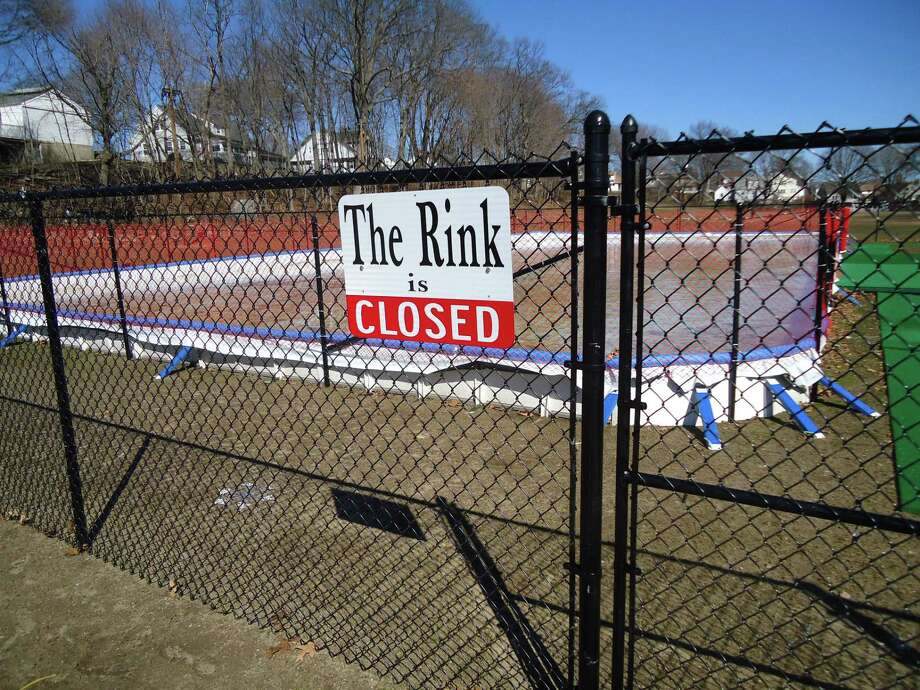 A warm winter has kept the ice rink set up in Stratford's Longbrook Park closed. Officials are thinking about a refrigerated rink for next winter. This is how it looked on the morning of Sunday, March 5, 2017. Photo: John Burgeson / Connecticut Post