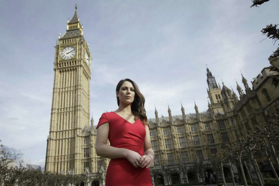 """Equality activist Nicola Thorp was told in December 2015 that her shoes were unacceptable for a temporary assignment in London with finance firm PwC. Her petition calling formal workplace dress codes """"outdated and sexist"""" was debated in Parliament on Monday. Photo: Tim Ireland /Associated Press / Copyright 2017 The Associated Press. All rights reserved."""