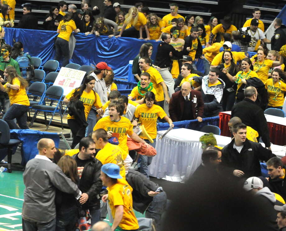 There were problems in 2010 when Siena students stormed the court after a MAAC title victory at Times Union Center. (Luanne Ferris/Times Union)