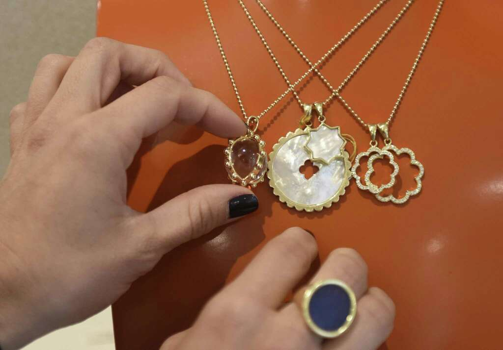 Asha designer and owner Ashley McCormick shows items from her collection. Photo: Tyler Sizemore / Hearst Connecticut Media / Greenwich Time