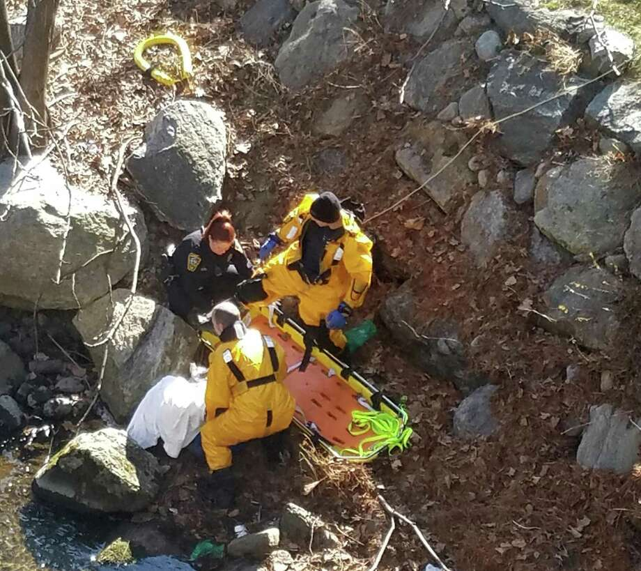 First responders come to the aid of a man who had fallen into the Norwalk River in front of 601 Merritt 7 in Norwalk, Conn. on Monday, March 6, 2017. Photo: Norwalk Fire Dept. / Contributed Photo / Norwalk Hour contributed
