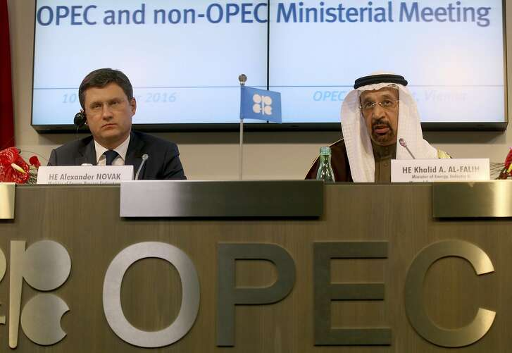 FILE  - In this Saturday, Dec. 10, 2016 file photo, Russian Minister of Energy Alexander Novak, left, and Khalid Al-Falih, Minister of Energy, Industry and Mineral Resources of Saudi Arabia attend a news conference after a meeting of the Organization of the Petroleum Exporting Countries, OPEC, at their headquarters in Vienna, Austria.  OPEC and key non-OPEC oil producers are near their target of taking 1.8 million barrels of crude a day off global markets less than two months after agreeing to do so in efforts to push up the price of crude, Russia's energy minister said Sunday, Jan. 22, 2017. Novak's upbeat comments to reporters came at the end of the first meeting of a joint OPEC-non-OPEC committee set up to monitor compliance to the Dec. 10 agreement. (AP Photo/Ronald Zak, FIle)