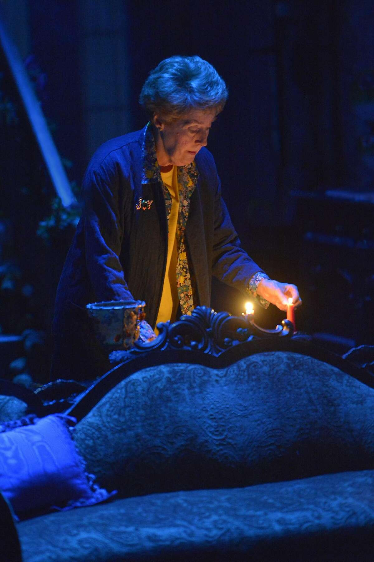 """Mertis (Georgia Engel) lights the candles in her bed-and-breakfast in ACT's """"John."""""""