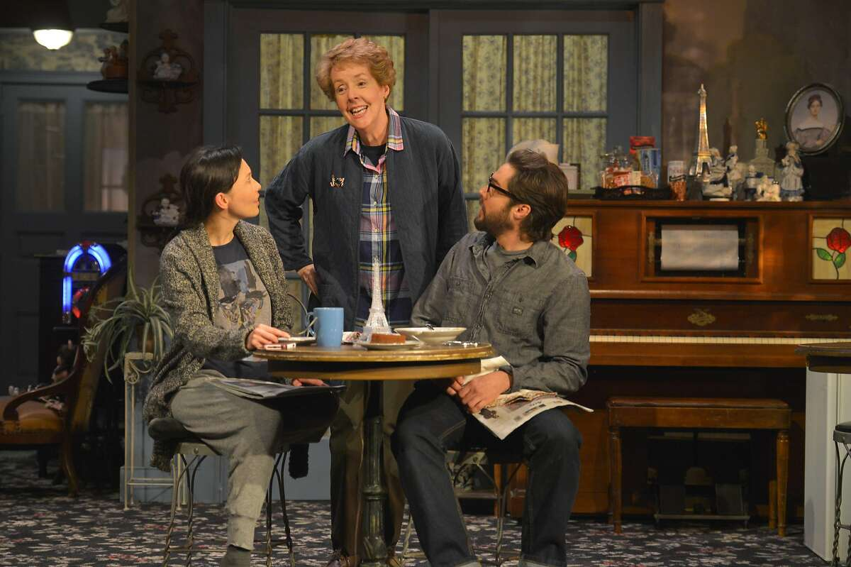 "Bed-and-breakfast owner Mertis (Georgia Engel, center) tells Elias (Joe Paulik) and Jenny (Stacey Yen) stories over breakfast in ACT's ""John."""