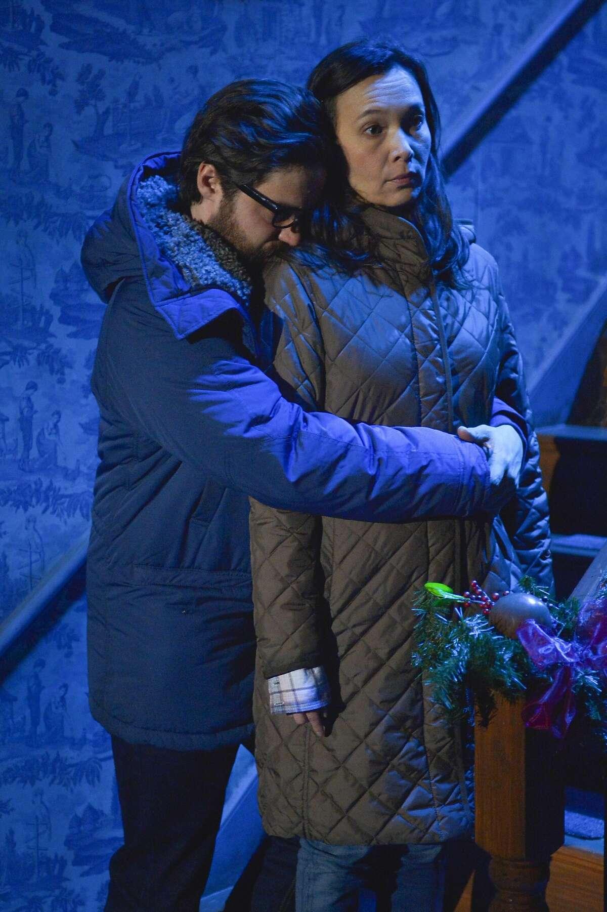 "Elias (Joe Paulik) and Jenny (Stacey Yen) embrace in ACT's ""John."""