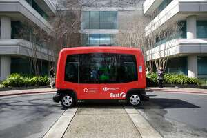 An EZ10 Shared Autonomous Vehicle (SAV) takes people on a route  around a parking lot at Bishop Ranch on Monday, March 6, 2017 in San Ramon, Calif.