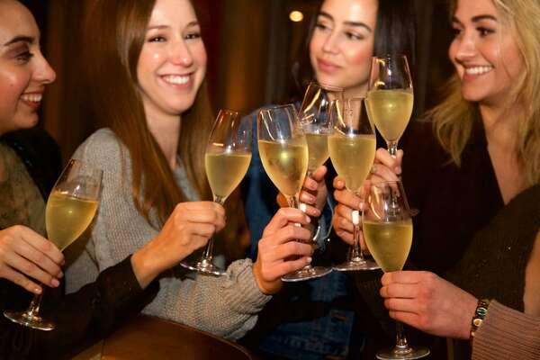 Clarissa Robles, Brittany Angelos, Andrea Lerma, and Katia Goga are sharing a toast at Sukeban. Photo By: Xelina Flores