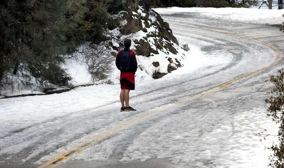Ryan Berry of Brentwood wore shorts on his trek to the summit of Mt. Diablo State Park which received a couple of inches of snow during the latest storm to move across the Bay Area as seen on Mon. March 6, 2017, near Danville, Ca. Photo: Michael Macor, The Chronicle