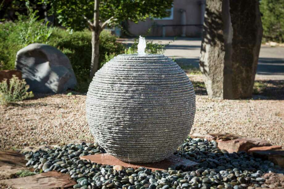 Stone Forest has introduced its Ribbed Sphere Fountain, carved from a single block of granite. Water flowing over the fissures in the stone create a wavy pattern and soothing sound. It's available in diameters of 20 inches, 24 inches and 36 inches — 350 to 2,500 pounds each. Photo: Stone Forest / Eric Swanson