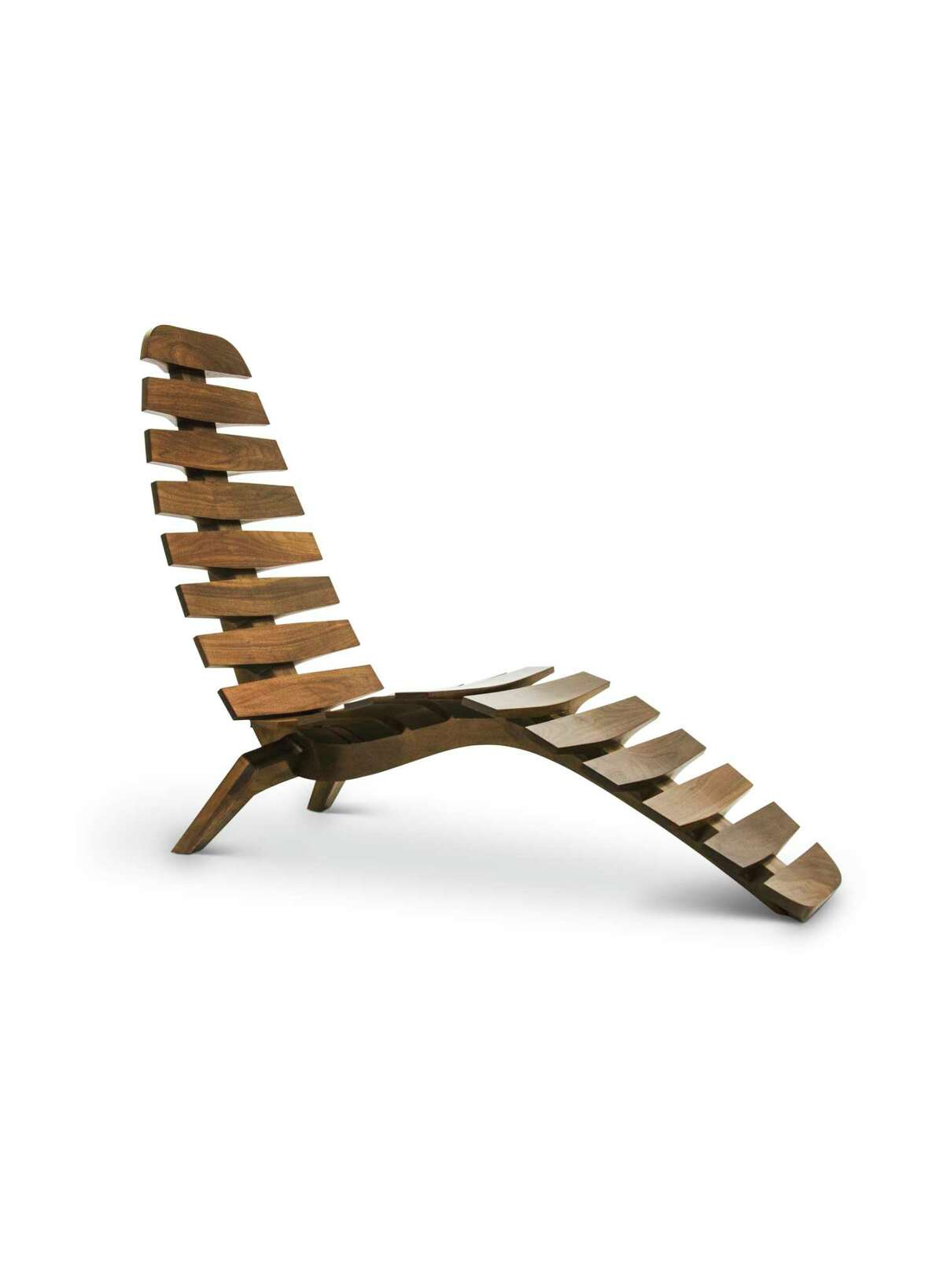 Designed by Don Howell for Hellman-Chang, the Sternum Chaise is made of teak and was inspired by the human spine and ergonomics.