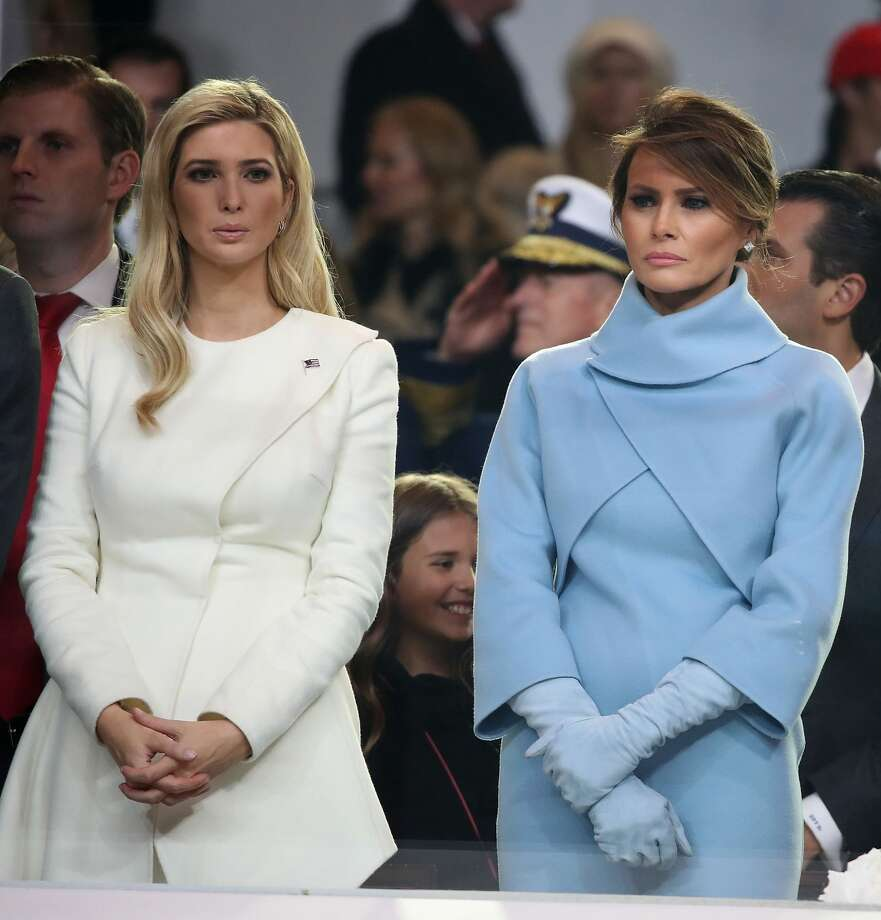 First lady Melania Trump (R), stands with Ivanka Trump as a parade passes the inaugural parade reviewing stand in front of the White House on Jan. 20, 2017 in Washington, DC.Keep clicking to see every outfit Melania and Ivanka have worn (so far). Photo: Mark Wilson/Getty Images
