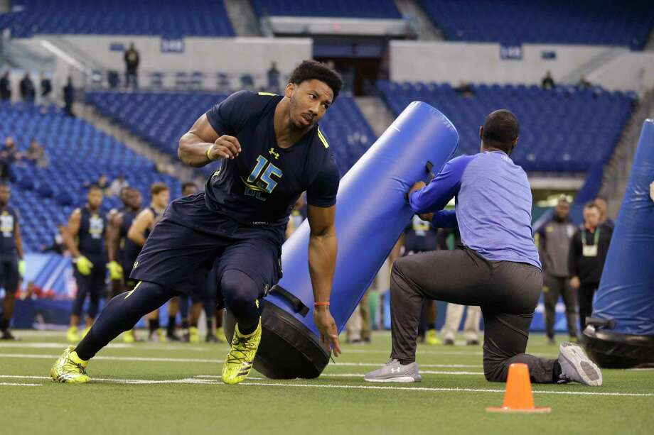 Texas A&M defensive end Myles Garrett runs a drill at the NFL football scouting combine in Indianapolis, Sunday, March 5, 2017. (AP Photo/Michael Conroy) Photo: Michael Conroy, STF / Copyright 2017 The Associated Press. All rights reserved.