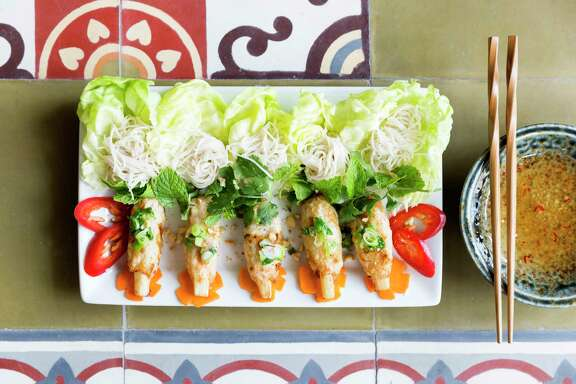 Le Colonial serves chao tom, grilled shrimp mousse on sugar cane with wheat noodles, lettuce and peanut plum dipping sauce.