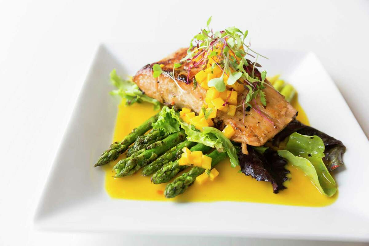 Ca Nuong (grilled Atlantic salmon and asparagus with minted mango sauce) at Le Colonial, a new restaurant at River Oaks District.