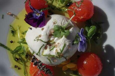 Burrata salad at Potente, a new upscale Italian restaurant in downtown Houston