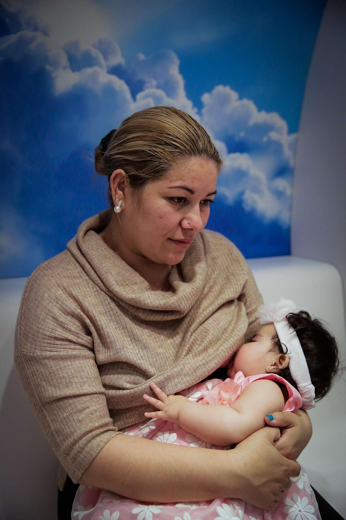 Mavet Coronel breastfeeds her daughter Allison Coronel, 6 months in the lactation pod at City Hall in San Francisco, California, on Monday, March 6, 2017.