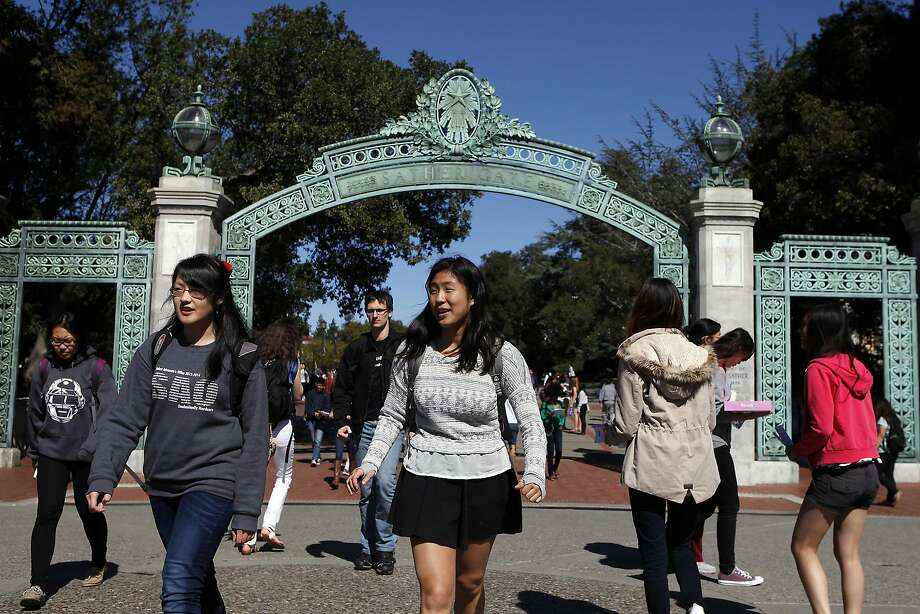 Students walk past  Sather Gate into Sproul Plaza on the Cal campus in Berkeley, CA, Tuesday, March 11, 2014.   State legislature is considering restoring the ability of California universities to use race and ethnicity in admissions decisions. Photo: Michael Short, The Chronicle