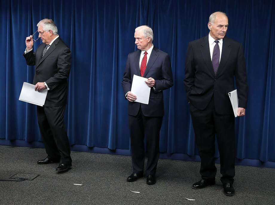 Secretary of State Rex Tillerson (left), Attorney General Jeff Sessions and Department of Homeland Security Secretary John Kelly outline the revised policy on travel to the country. Photo: Mark Wilson