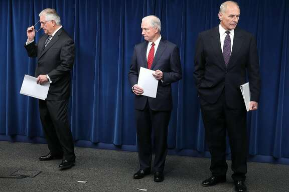 WASHINGTON, DC - MARCH 06:  Attorney General Jeff Sessions (C), Secretary of Homeland Security John Kelly (R) and Secretary of State Rex Tillerson (L) take part in a news conference about issues related to a reconstituted travel ban at the U.S. Customs and Borders Protection headquarters, on March 6, 2017 in Washington, DC. Earlier today, President Donald Trump signed an executive order that excludes Iraq from the blacklisted countries but continues to block entry to the U.S. for citizens of Somalia, Sudan, Syria, Iran, Libya and Yemen. Kelly, Tillerson and Sessions left the news conference without taking questions.  (Photo by Mark Wilson/Getty Images) *** BESTPIX ***