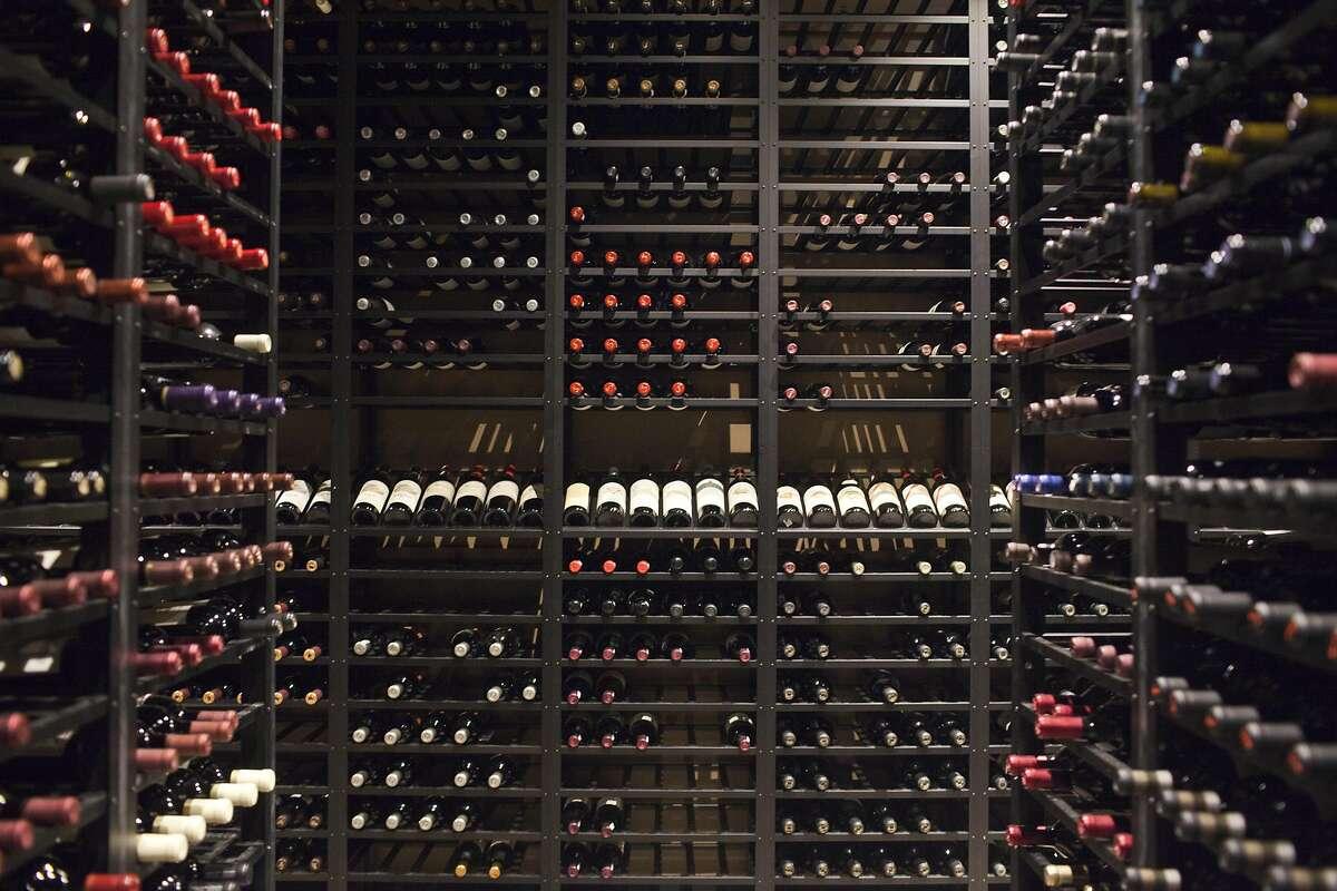 Vintage California bottles of wine fill the cellar at Press Restaurant in St Helena.