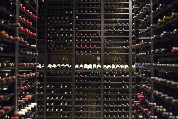 Vintage California bottles of wine fill the cellar at Press Restaurant in St Helena.