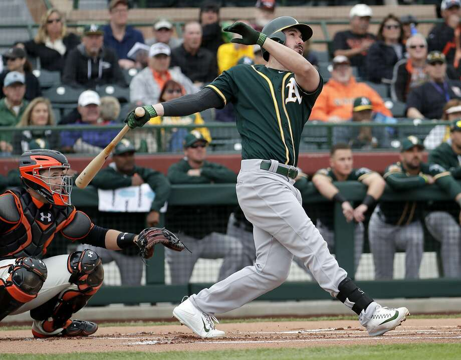 Oakland Athletics right fielder Matt Joyce (23) follows through on a solo home run during the first inning of a spring training baseball game against the San Francisco Giants, Monday, Feb. 27, 2017, in Scottsdale, Ariz. (AP Photo/Matt York) Photo: Matt York, Associated Press
