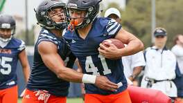 UTSA cornerbacks Devron Davis (left) and Austin Jupe work on drills during the opening day of spring practice on March 6, 2017.