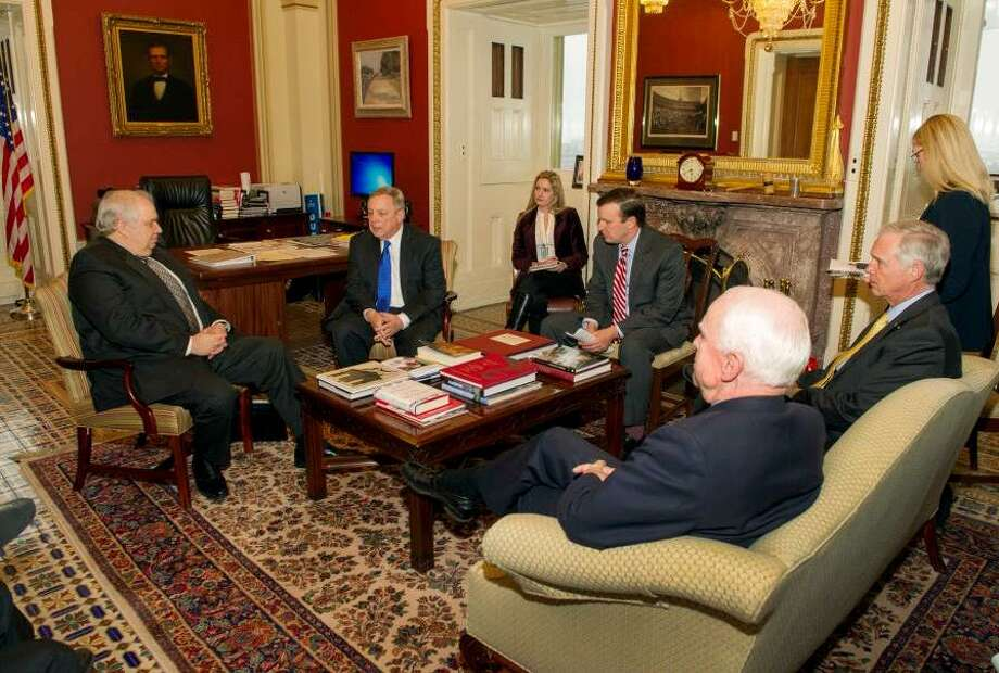 Senator Richard Durbin of Illinois joined U.S. Senators Ron Johnson (R-WI), Chris Murphy (D-CT) and John McCain (R-AZ), for a meeting with the Russian ambassador to the U.S., Sergey Kislyak, left, in Durbin's Capitol office to discuss the ongoing crisis in Crimea on March 27, 2014. Photo: Contributed Photo / Contributed Photo / Connecticut Post Contributed