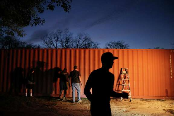 """A group of teenagers from The Church of Jesus Christ of Latter Day Saints and Boy Scout Troop 1042 paint a ship container that would become a house for a homeless veteran when it is completed Wednesday, March 1, 2017, in Montgomery. This was the first """"tiny house"""" that the Montgomery-based nonprofit Green Zone Housing started and hoped to continue."""