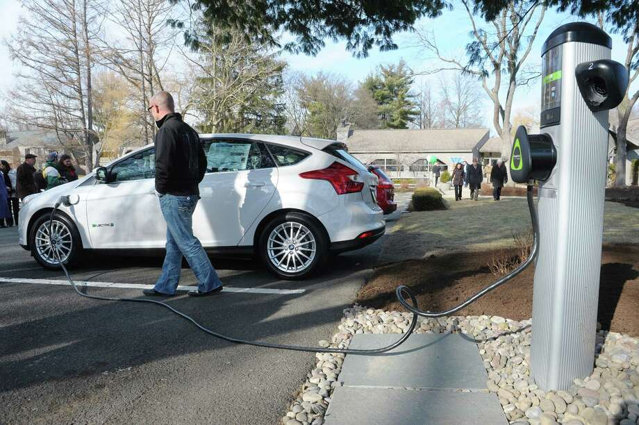 A Ford Focus Electric Car From Metro Of Albany Is Plugged Into Charging Station