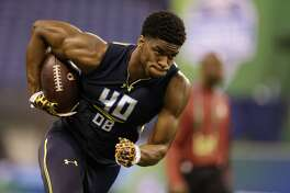 Connecticut defensive back Obi Melifonwu runs a drill at the NFL football scouting combine in Indianapolis, Monday, March 6, 2017. (AP Photo/Michael Conroy)