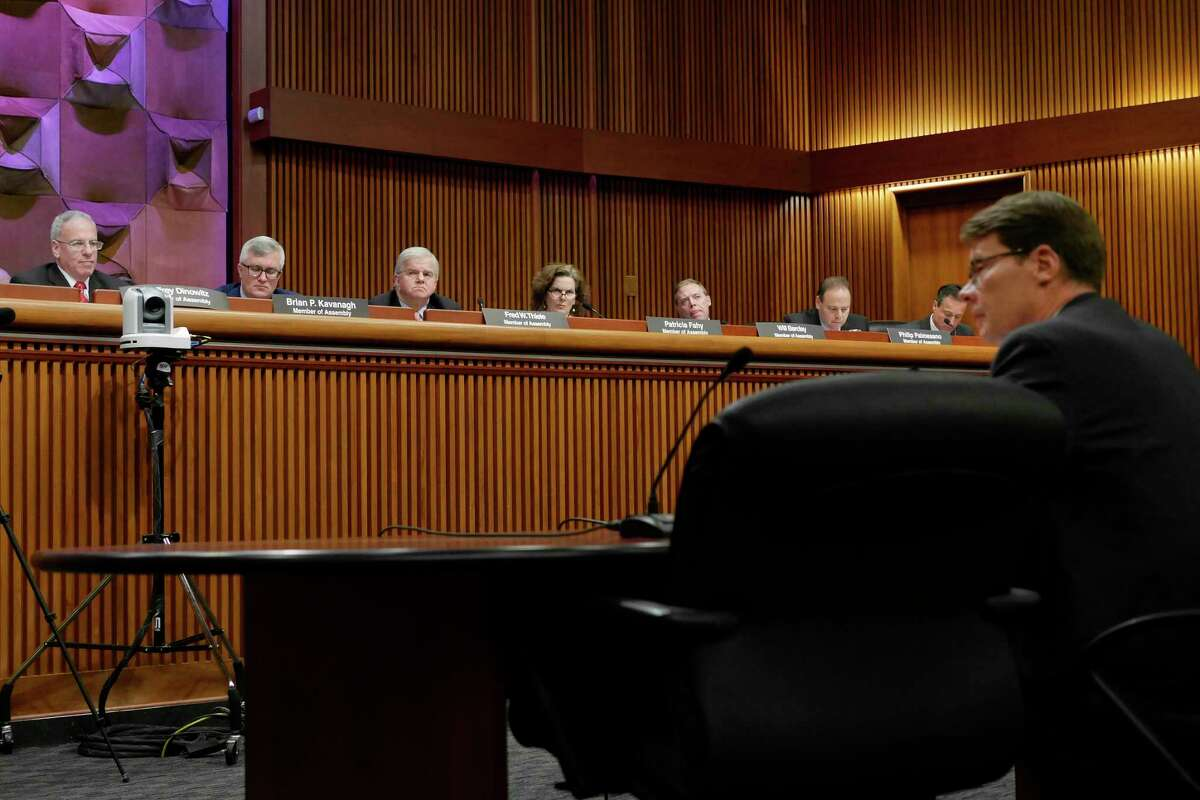 Legislators listen as Blair Horner, executive director of NYPIRG, testifies at a Assembly Standing Committees on Corporations, Authorities and Commissions hearing on Monday, March 6, 2017, in Albany, N.Y. (Paul Buckowski / Times Union)