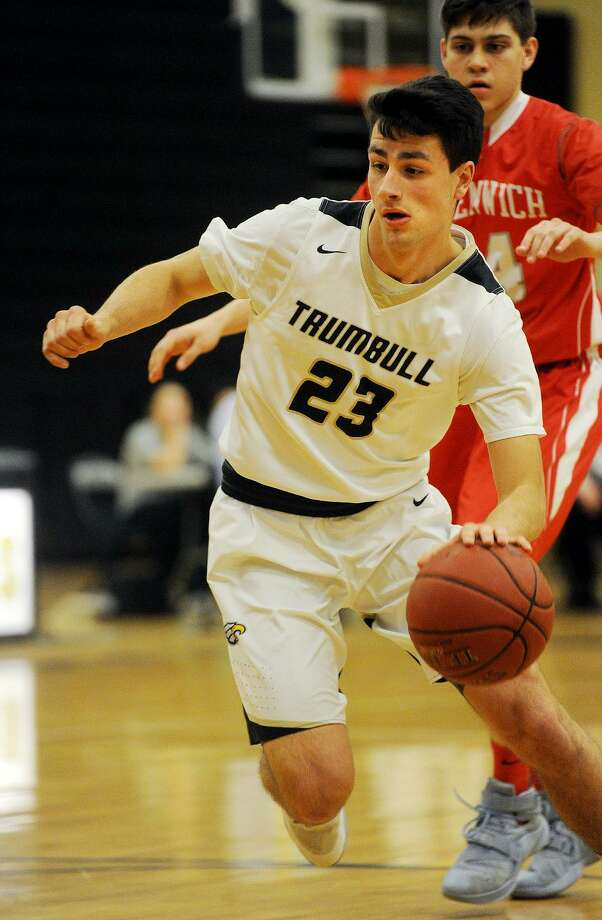 Trumbull's John McElroy drives to the basket during his team's defeat of Greenwich in the opening round of the Class LL State Playoffs at Trumbull High School in Trumbull, Conn. on Monday, March 6, 2017. Photo: Brian A. Pounds / Hearst Connecticut Media / Connecticut Post