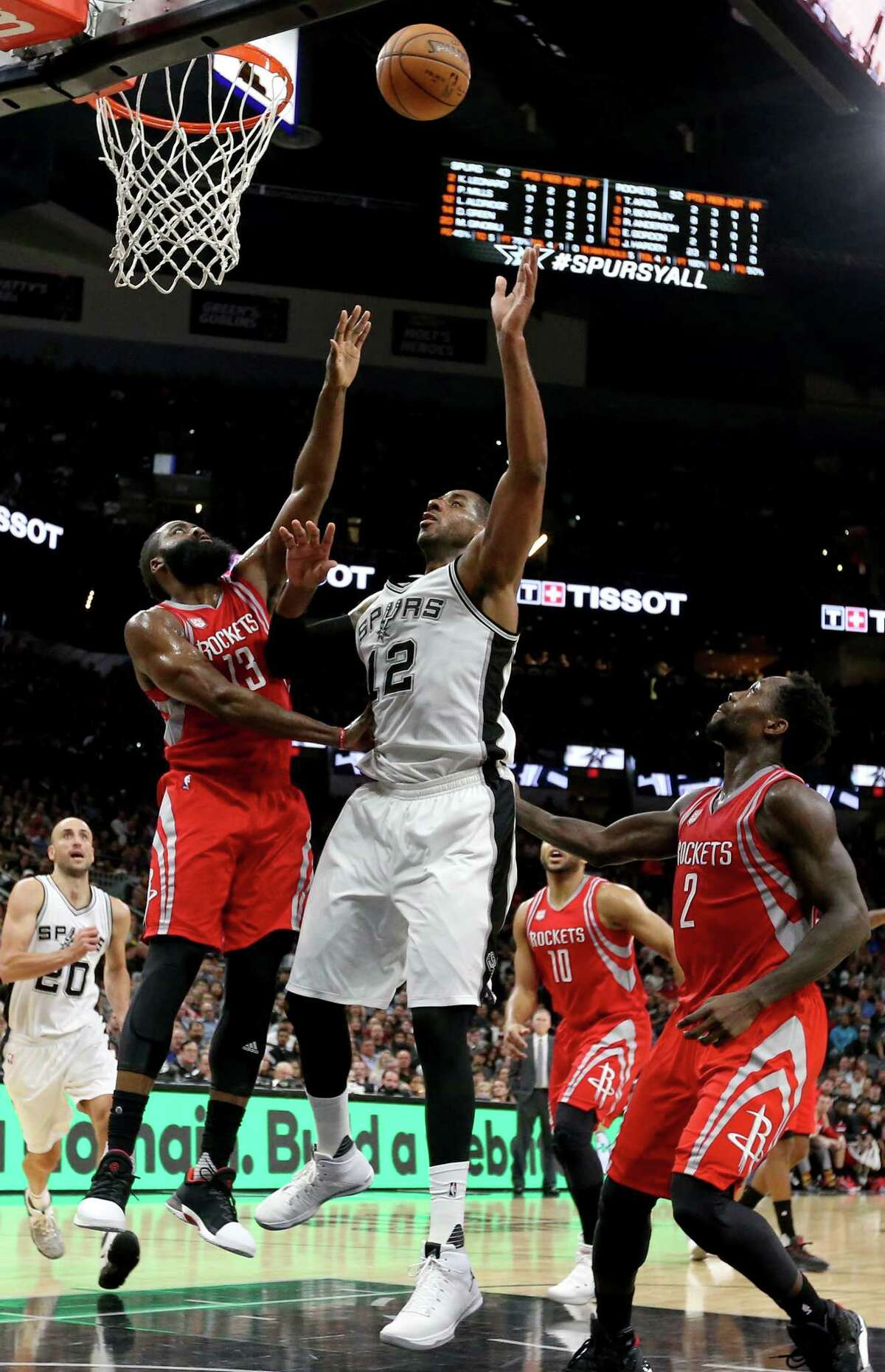 San Antonio Spurs' LaMarcus Aldridge shoots between Houston Rockets?• James Harden (left) and Patrick Beverley during first half action Monday March 6, 2017 at the AT&T Center.