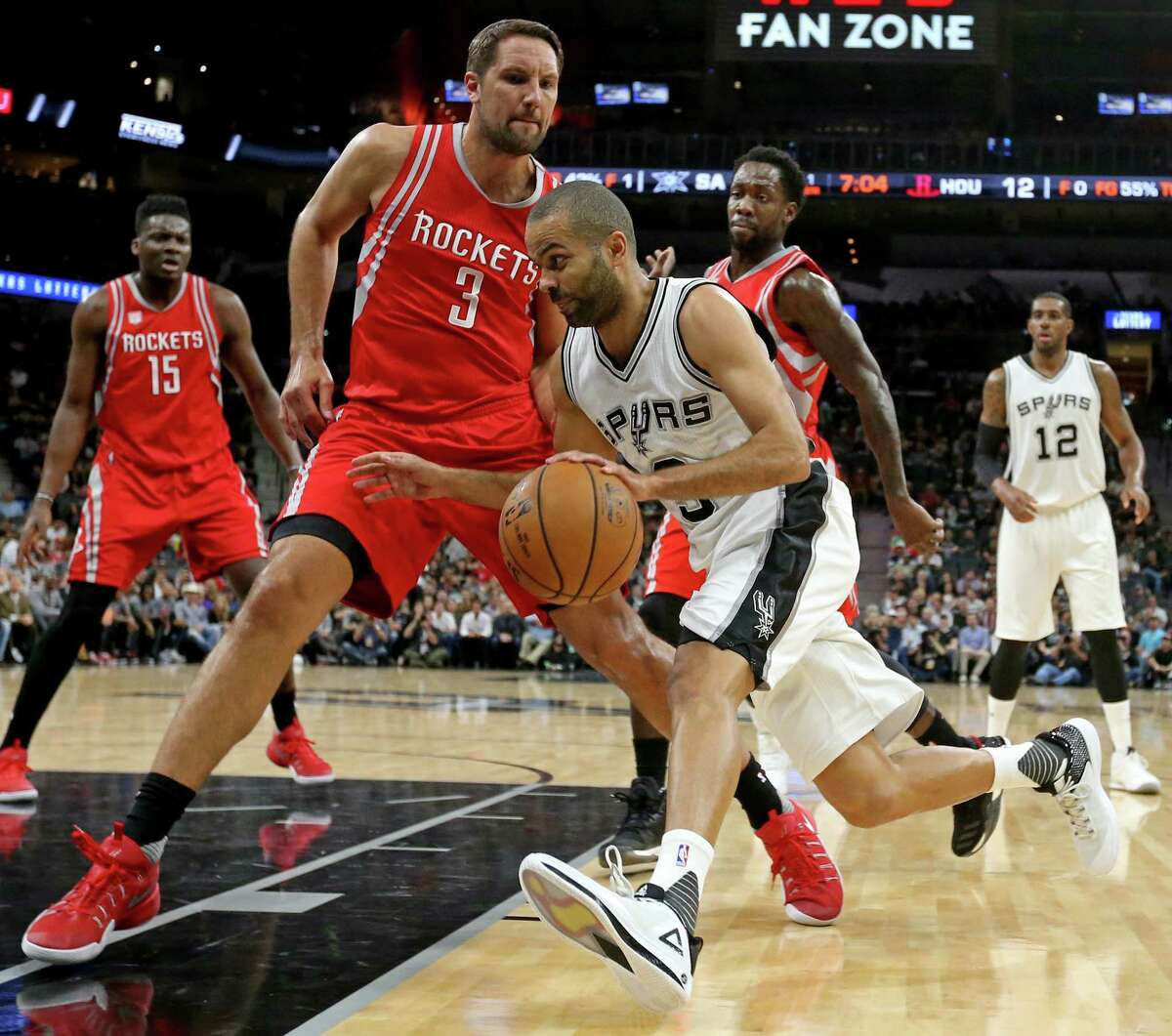 San Antonio Spurs' Tony Parker looks for room around Houston Rockets?• Ryan Anderson during first half action Monday March 6, 2017 at the AT&T Center.