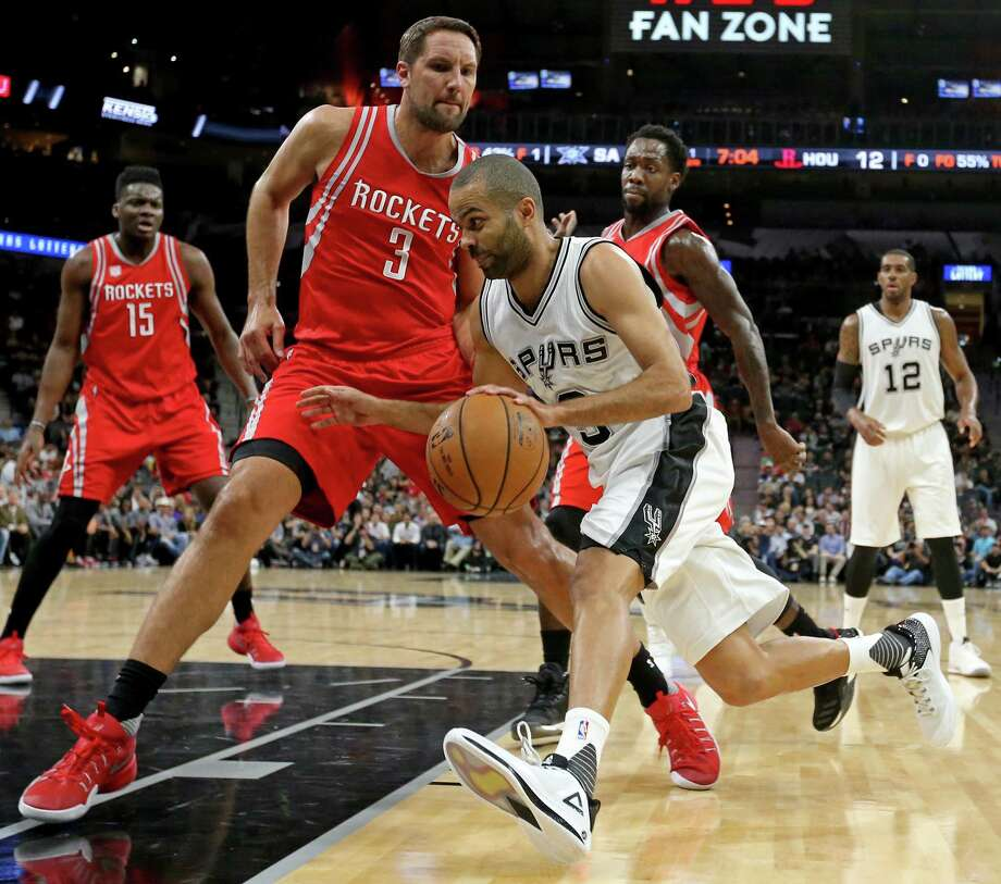 San Antonio Spurs' Tony Parker looks for room around Houston RocketsÕ Ryan Anderson during first half action Monday March 6, 2017 at the AT&T Center. Photo: Edward A. Ornelas, San Antonio Express-News / © 2017 San Antonio Express-News