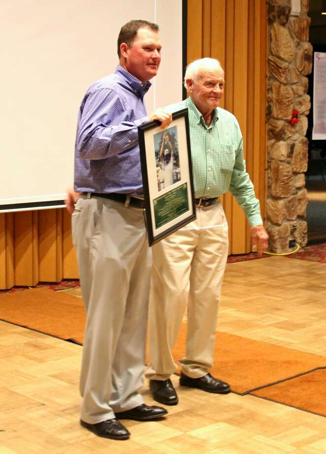 Chad Campbell stands next to Midland College golf coach Delnor Poss after being presented with his WJCAC Hall of Fame plaque. Photo: Forrest Allen ,  Special To MRT