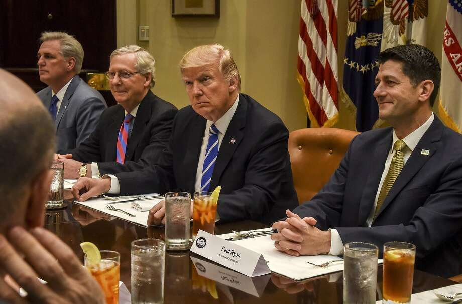 President Trump, shown with Republican leaders, including Senate Majority Leader Mitch McConnell, R-Ky., and House Speaker Paul Ryan, R-Wis., at the White House. Ryan is the chief architect of the Republicans' newly unveiled plan to replace the Affordable Care Act. Photo: Bill O'Leary, The Washington Post