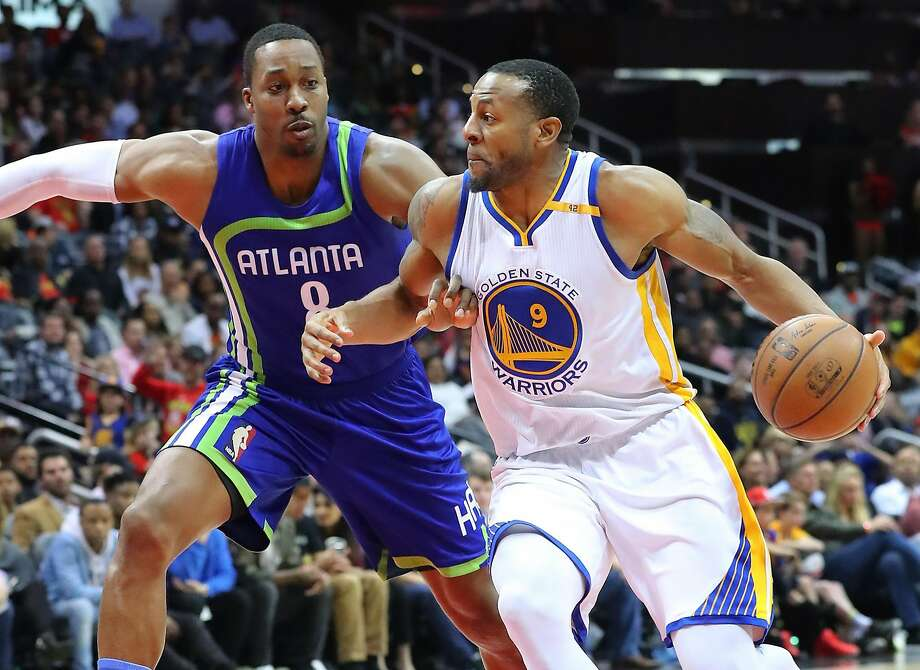Golden State Warriors' Andre Iguodala drives against Atlanta Hawks' Dwight Howard during the second half on Monday, March 6, 2017 in Atlanta, Ga. The Warriors beat the Hawks, 119-111. (Curtis Compton/Atlanta Journal-Constitution/TNS) Photo: Curtis Compton, TNS