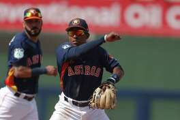 Houston Astros left fielder Tony Kemp (18) avoids Boston Red Sox' Brian Bogusevic (36) as he turns a double play on a Brock Holt (12) ground in the fourth inning of a spring training baseball game Monday, March 6, 2017, in West Palm Beach, Fla. (AP Photo/John Bazemore)