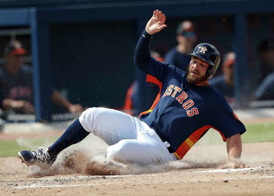 Houston Astros' Tyler White (13) scores on a George Springer base hit in the first inning of a spring training baseball game against the Boston Red Sox Monday, March 6, 2017, in West Palm Beach, Fla. (AP Photo/John Bazemore) Photo: John Bazemore, STF / Copyright 2017 The Associated Press. All rights reserved.