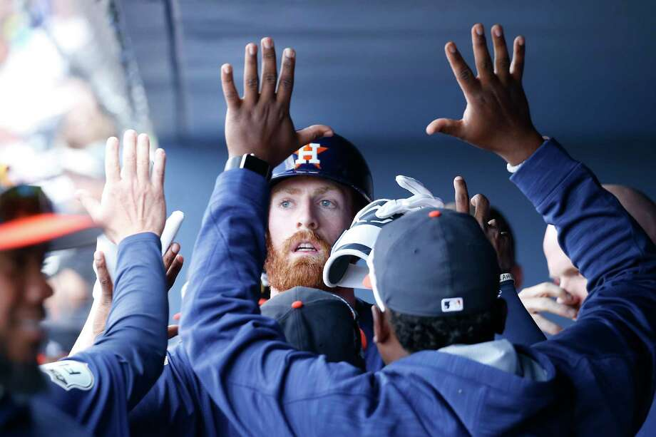 WEST PALM BEACH, FL - MARCH 6: Colin Moran #19 of the Houston Astros is congratulated after hitting a home run to tie the game against the Boston Red Sox in the eighth inning during a spring training game at The Ballpark of the Palm Beaches on March 6, 2017 in West Palm Beach, Florida. The Astros and Red Sox played to a 5-5 tie. (Photo by Joel Auerbach/Getty Images) Photo: Joel Auerbach, Stringer / 2017 Getty Images