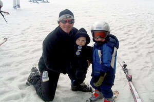 Larry Davis on a skiing trip with is family around 2010.