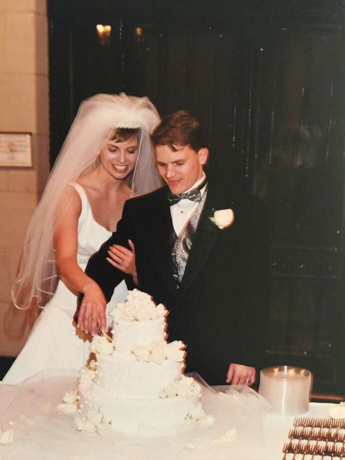 Larry and Stacy Davis cut the cake at their wedding in 2000. Now 44, Larry Davis has spent a year in a Dominican Republic jail on drug trafficking charges. Photo: Photo Courtesy Of Stacy Davis / Photo courtesy of Stacy Davis